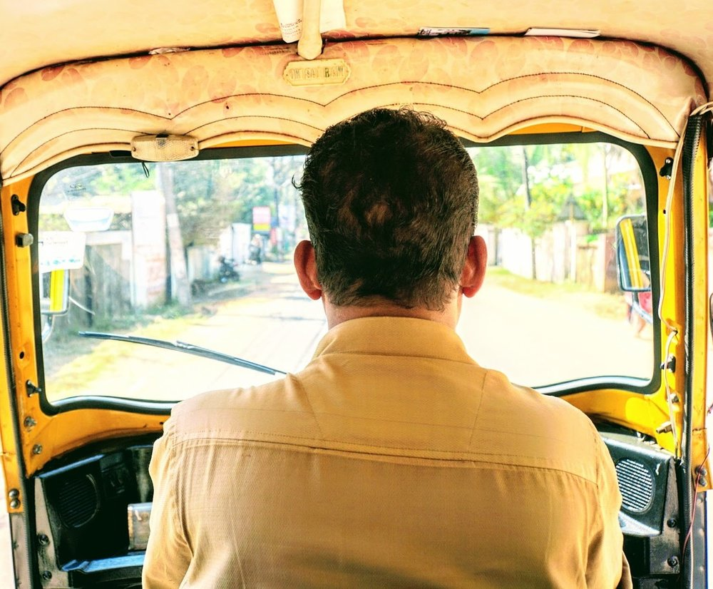 organized chaos: a tuk-tuk driver navigates the streets of alleppey.