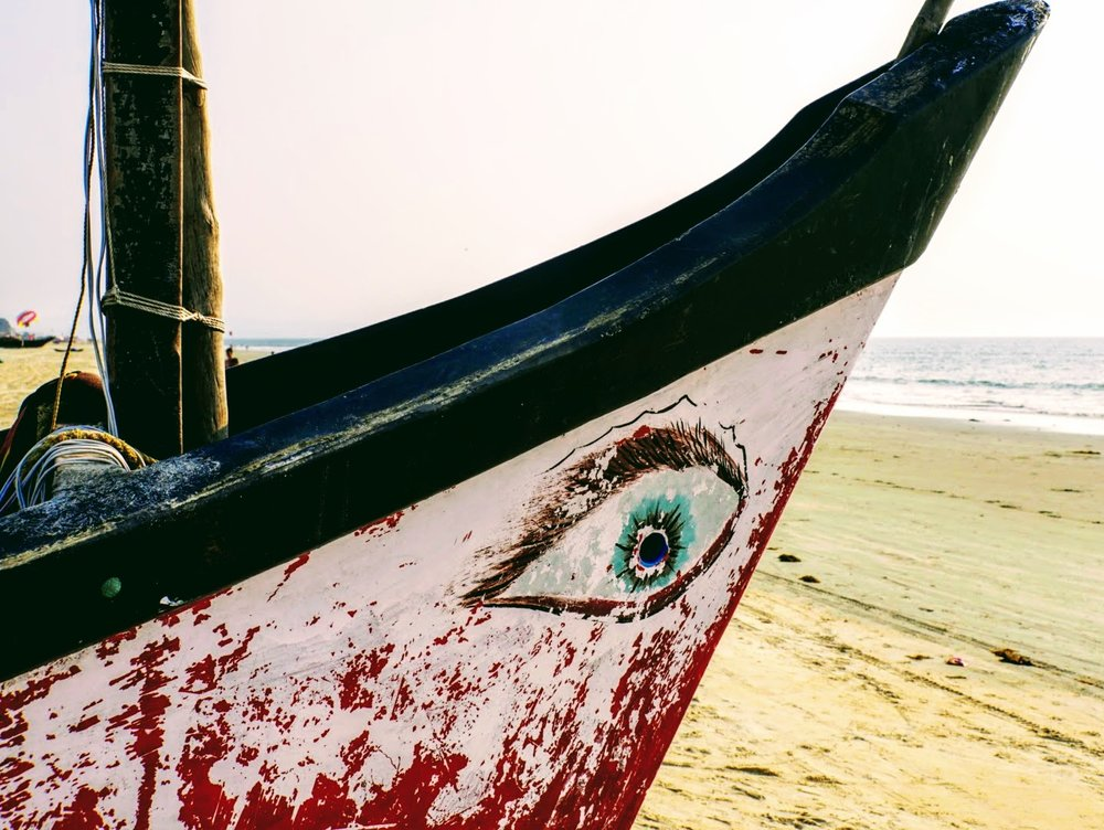 south goa's benaulim beach: cool boats and cold beer