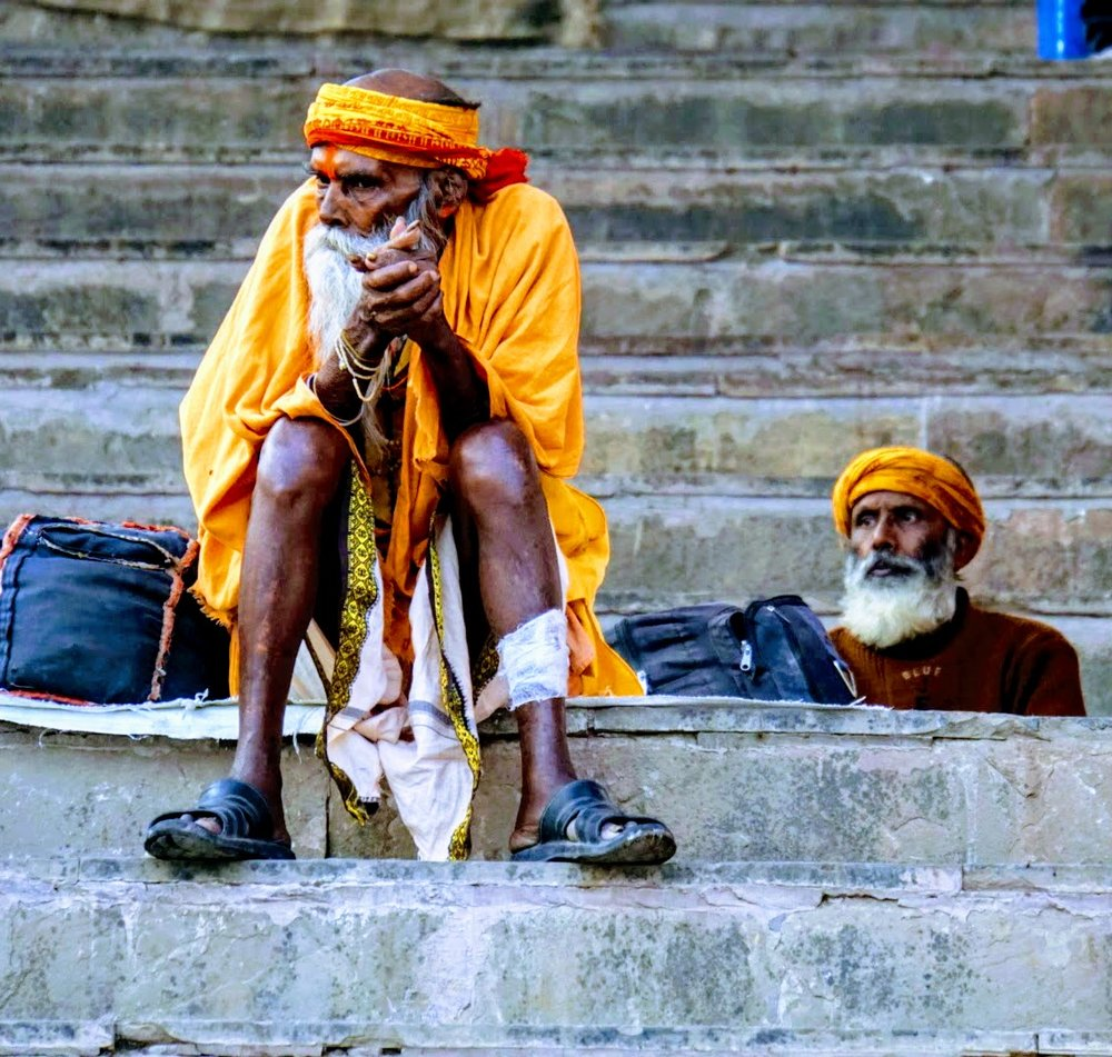 A swami in deep thought along the banks of the Ganges River in Varanasi, India.