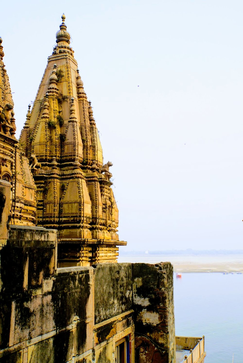 A temple rising above the ghats along the Ganges in Varanasi, India.