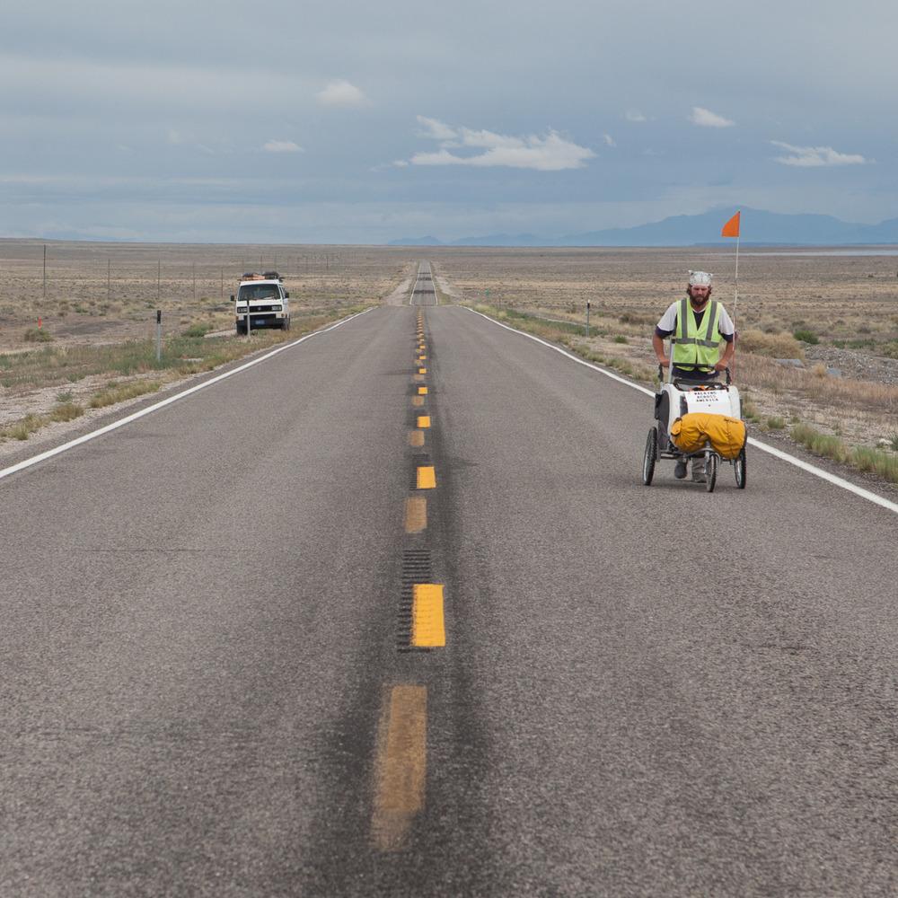 Kenyon takes off again walking along the road, heading to California