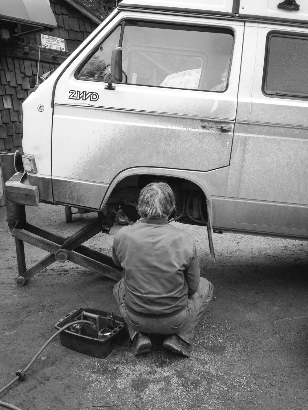 A mechanic works on my broken Volkswagen Vanagon