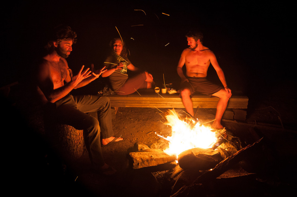Having a fireside chat with some hitchhikers I had just picked up in Canada