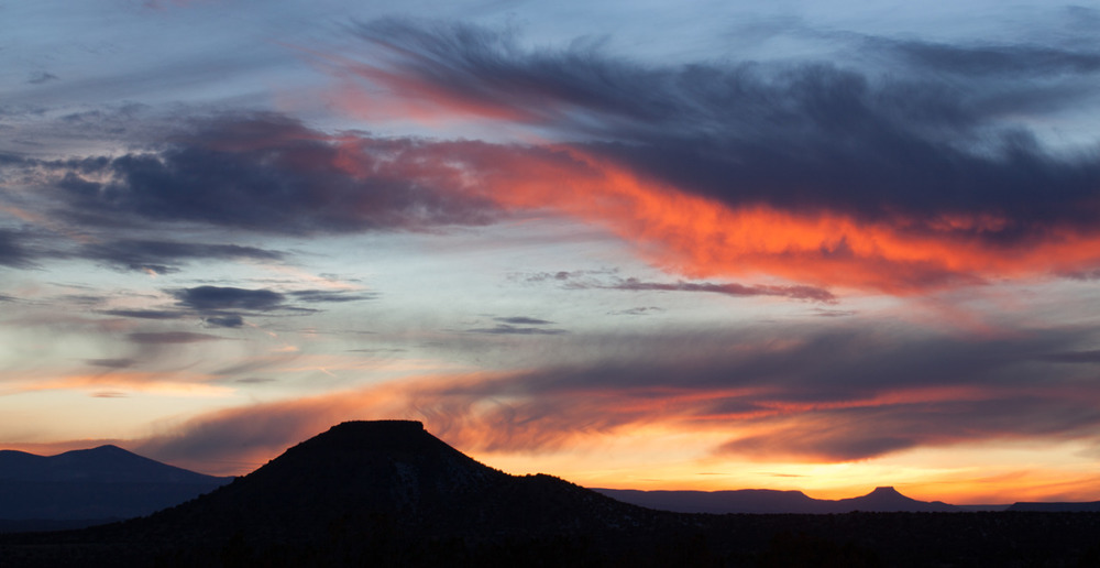 Buttes at sunset outside of Ojo Caliente, New Mexico