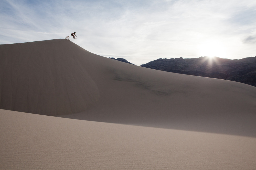 Jumping off a sand mountain in the Eureka Dunes area of Death Valley