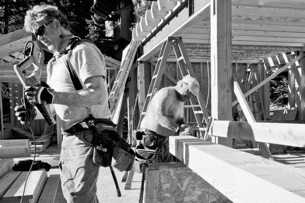 Construction workers in Lake Tahoe building in January without their shirts on
