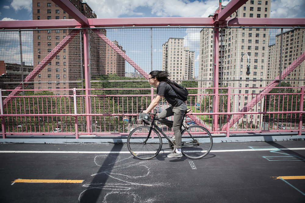 Woman commuting on her bike Williamsburg Bridge, New York