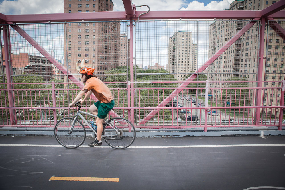 Man riding his bike on the Williamsburg Bridge, New York