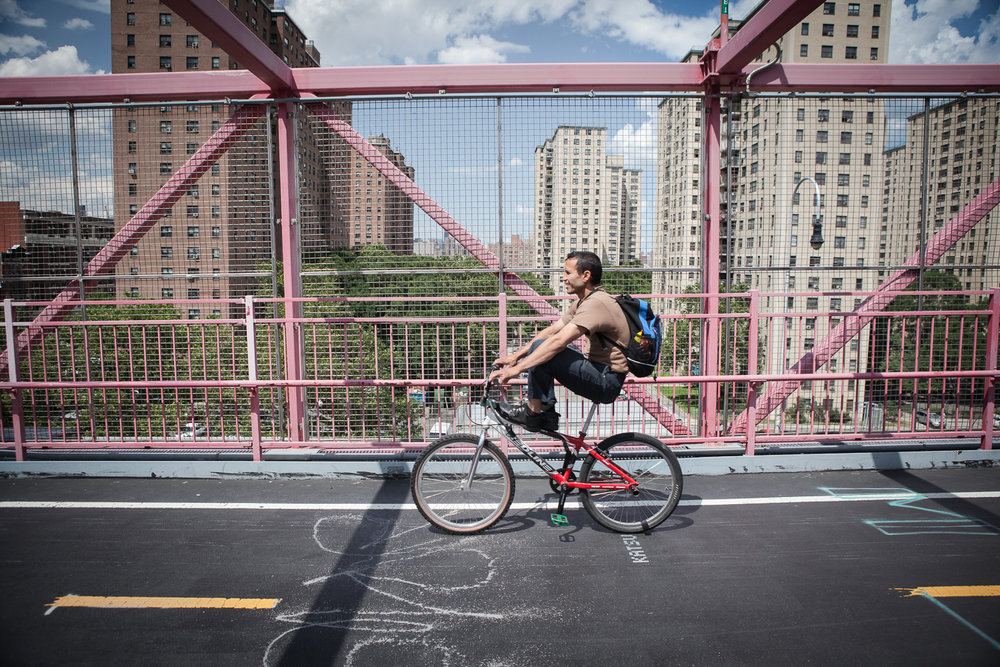 Man commuting on his bike Williamsburg Bridge, New York
