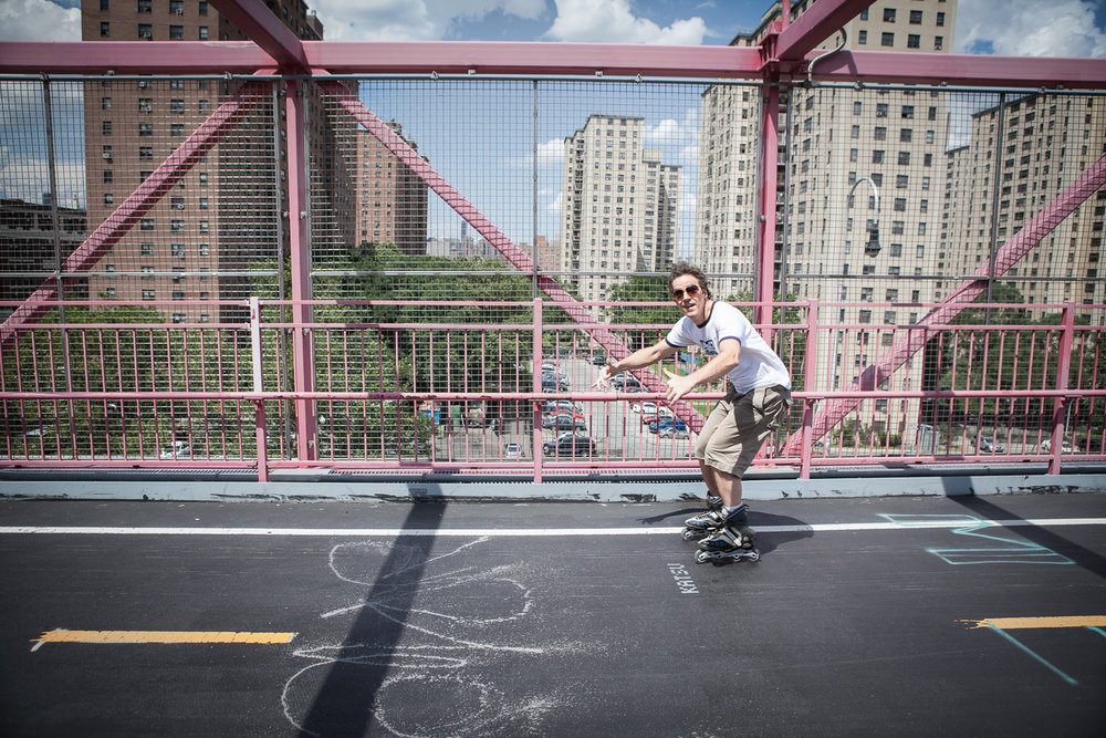 Man rollerblading on the Williamsburg Bridge, New York