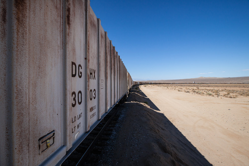 Abandoned train stretches out as far as the eye can see in the desert