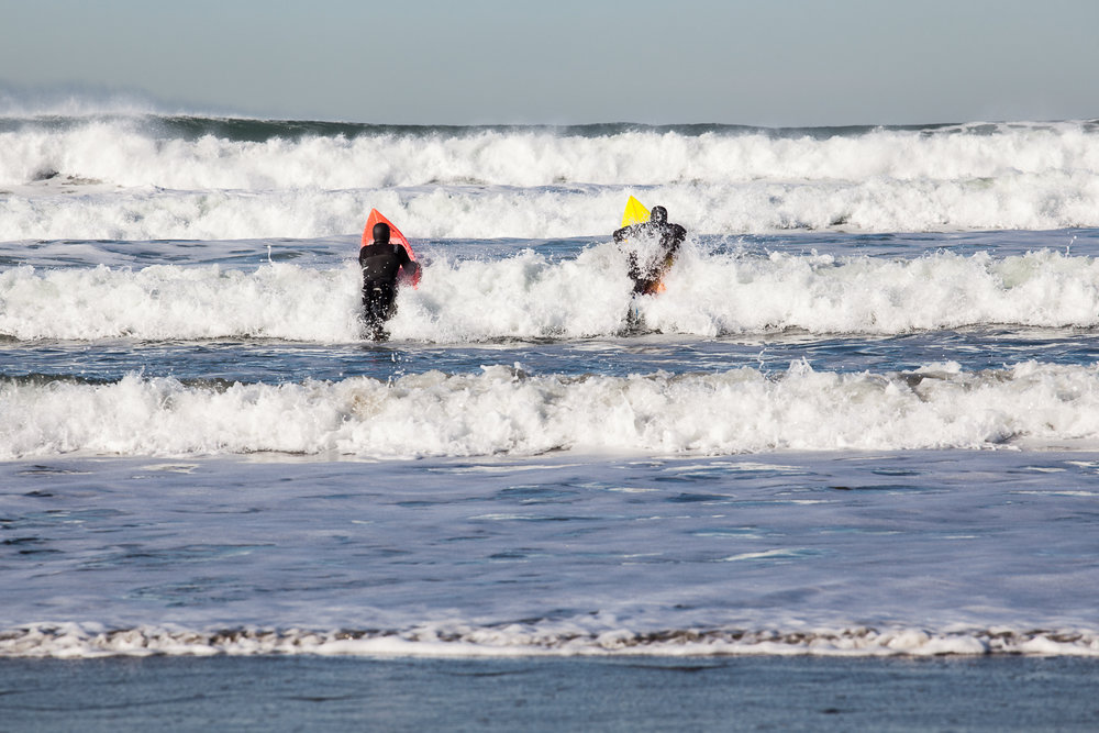 Keenan and Sam paddle out to surf big waves at Ocean Beach, San Francisco