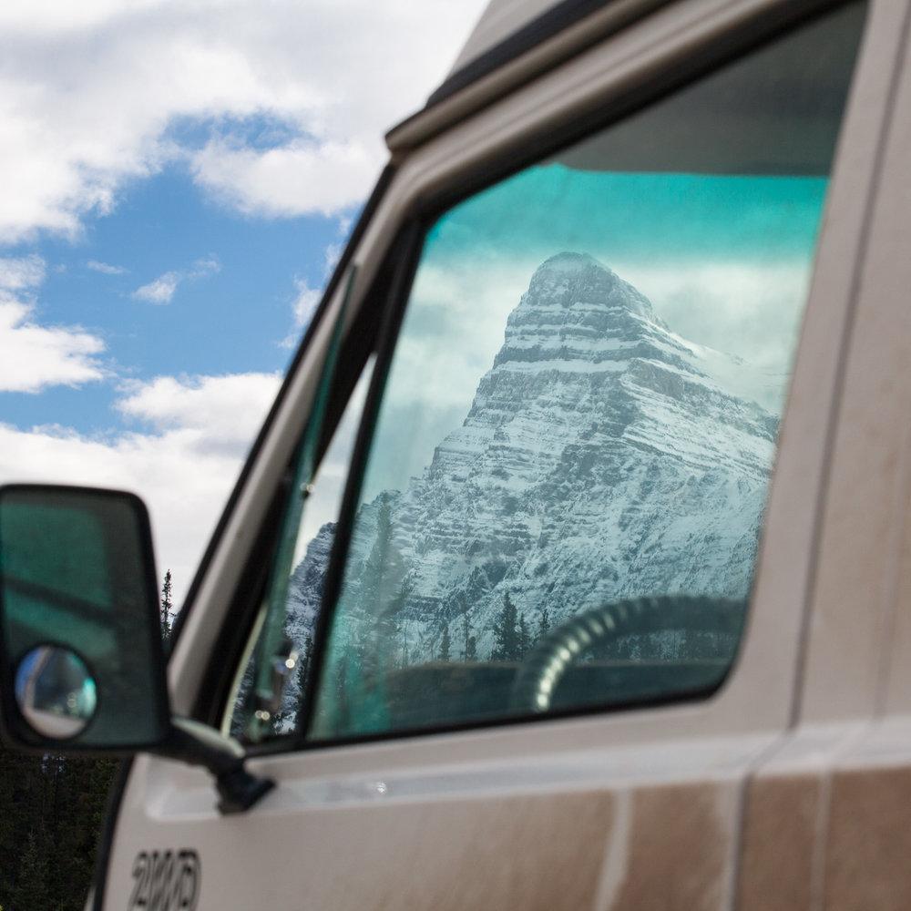Looking through a Volkswagen Vanagon window to the Canadian Rockies