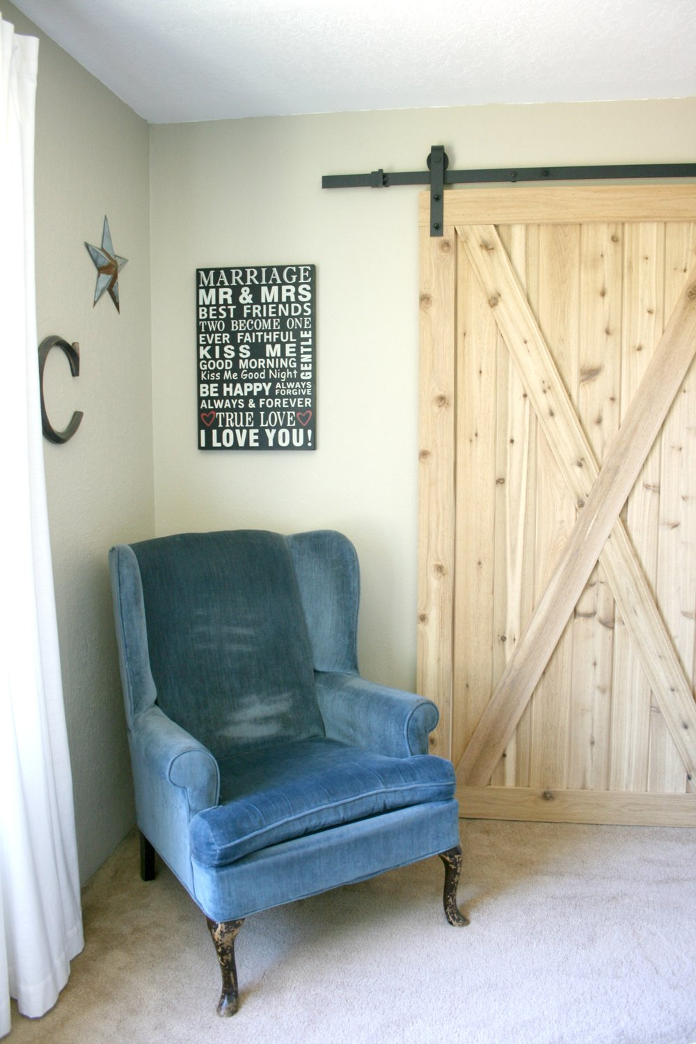 old blue chair and barn door.jpg