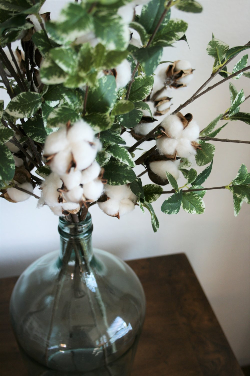 cotton stems and greenery in vase