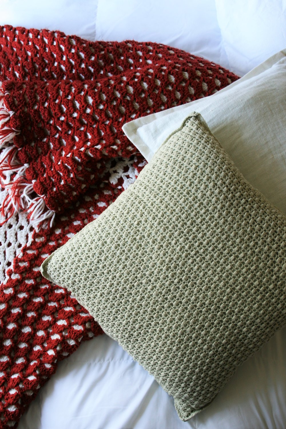 cozy blanket and textured pillows