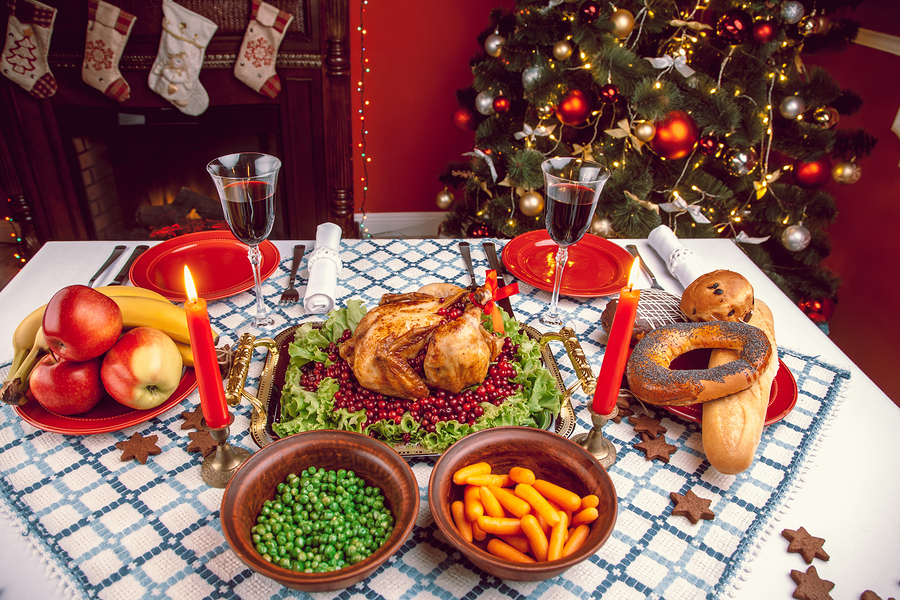 bigstock-Christmas-Dinner-By-Candleligh-153113588.jpg