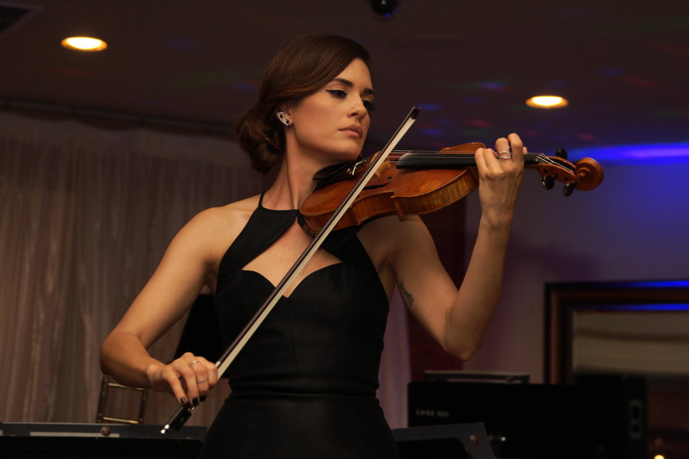 Actress Torrey DeVitto performing at New Horizons Gala