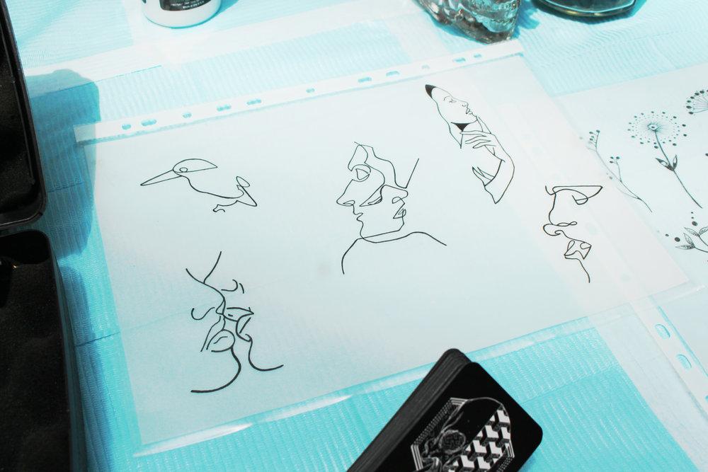Hand-drawn tattoo designs by Chris Sim
