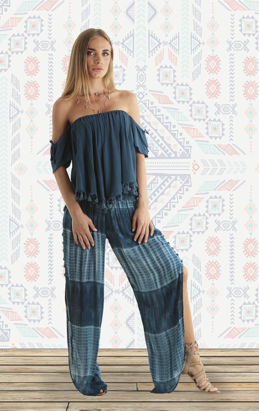 TOP ONYX Cap-slv off-shoulder top w/ tassels RAYON VOIL | XS, S/M, M/L – PANTS SKY Smock-waist, open sides, tapered-leg genie pants RAYON VOIL | XS-S-M-L