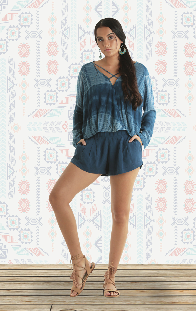 TOP SHINE L/s deep v-top w/ criss cross front straps, front straps tucked pleated panels RAYON VOIL | XS-S-M-L – SHORTS REVEL High waisst shorts w/ pleated wide waistband, front pkts, elastic back waistband RAYON VOIL | XS-S-M-L