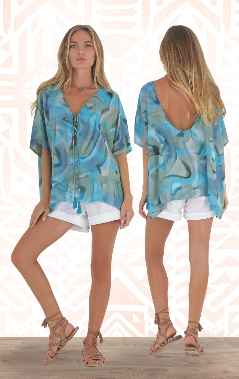 TOP SHINE Caftn style slvs high low flowy top, w/ tie front pom pom detail, open back RAYON VOILE | XS/S-M/L   –       SHORTS ZANZIBAR Fold waistband shorts, front pockets, cuffed hem 100%  NYLON | XS-S-M-L