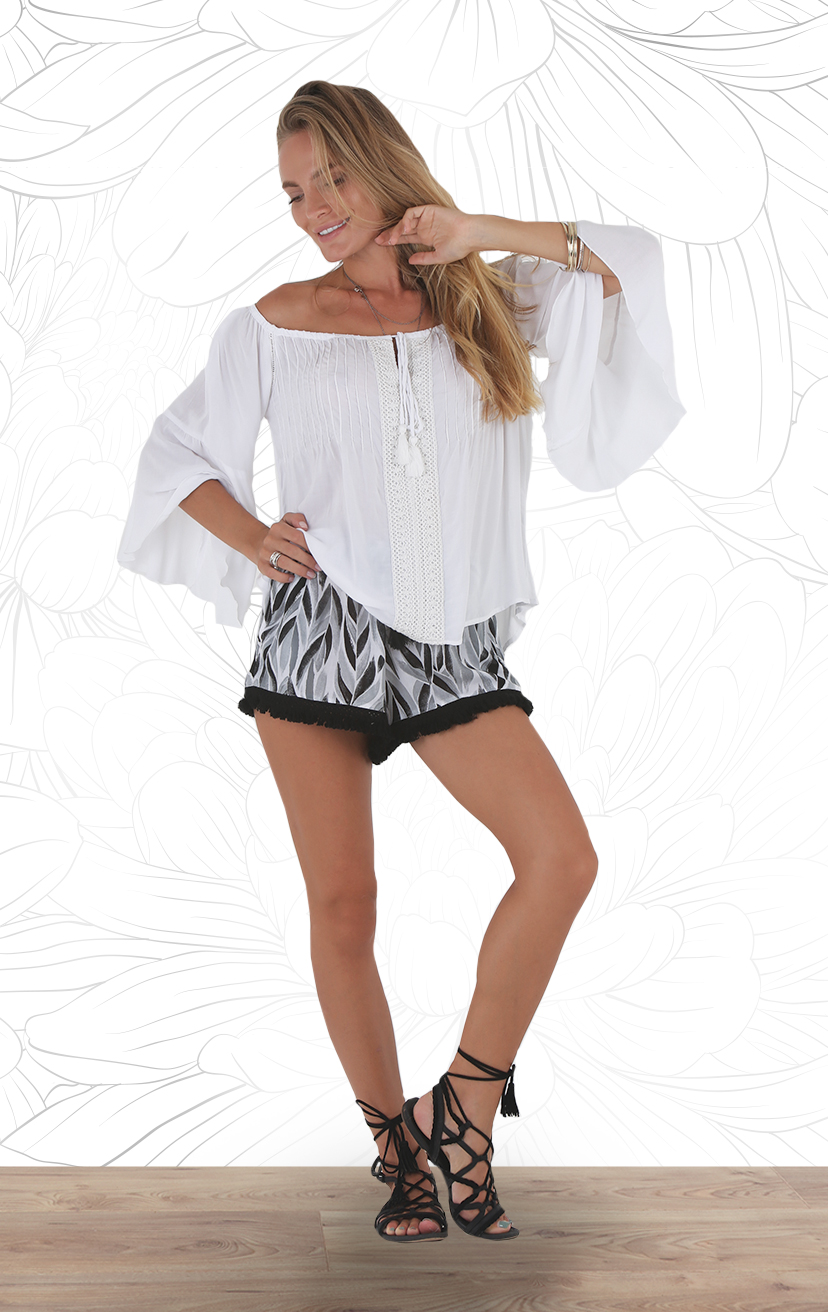 TOP SENANG Off shoulder bell slv, w/ heyhole drawstring tie, front lace top RAYON VOILE | XS-S-M-L –     SHORTS SAMANA Elastic drawstring w/ pom pom, side pockets, fringed hem shorts RAYON VOILE | XS-S-M-L