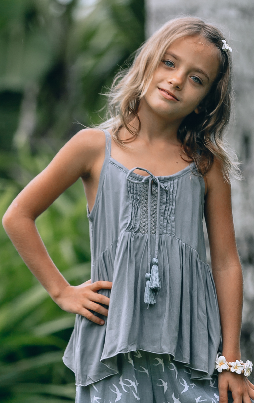 TOP NIKITA Spaghetti strap top, center lace detail, pom pom ties RAYON VOILE | 2/3 | 4/5 | 6/7 | 8/10 – PANT START Smock-waist, slits down the sides pant RAYON VOILE | 2/3 | 4/5 | 6/7 | 8/10