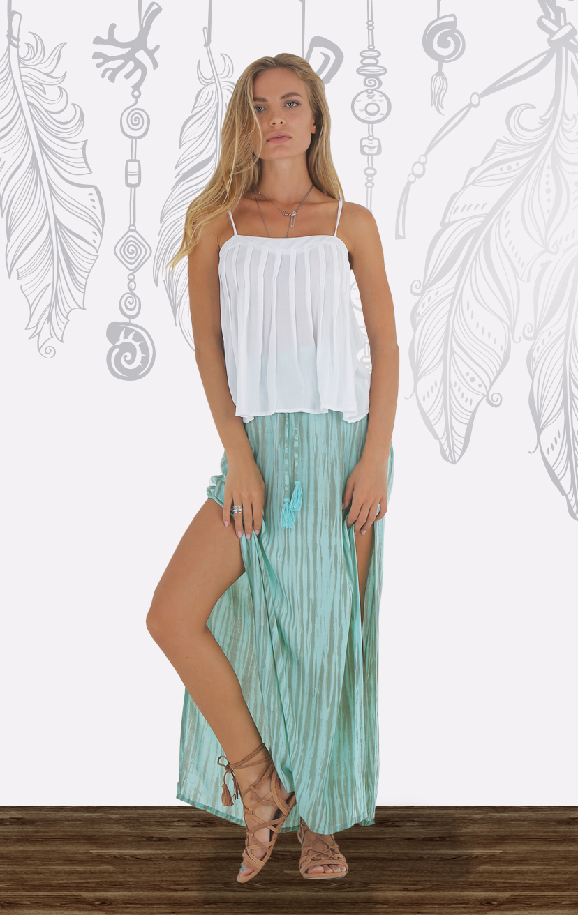 TOP ALYNA Spaghetti strap baby doll top, with pleat front detailA RAYON VOILE | XS-S-M-L –    SKIRT IOLANI Long skirt, side slits, tie waist with pom pom RAYON VOILE | XS-S-M-L