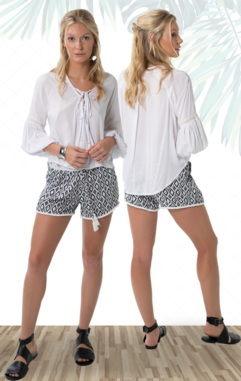 TOP LUX V-neck l/s high-low top, front lace up tie w/ tassel, surplice front, puffy slvs, elastic cuffs 100% RAYON   XS-S-M-L – SHORTS DEEPSEA Elastic lace waistband, w/ pom pom drawstrings and lace trim hem 100% RAYON   XS-S-M-L