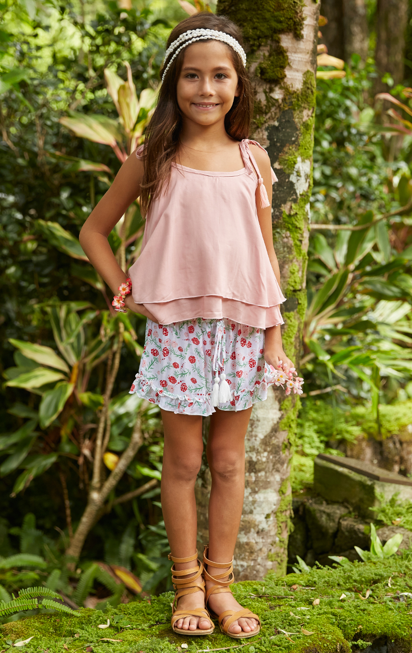 TOP BUZZY   Double layered top, shoulder ties with pom pom  100% RAYON | 2/3 | 4/5 | 6/7 | 8/10  –   SHORTS BLOOMIN   Elastic waist shorts w/ pom pom ties, bottom ruffle hem  100% RAYON | 2/3 | 4/5 | 6/7 | 8/10