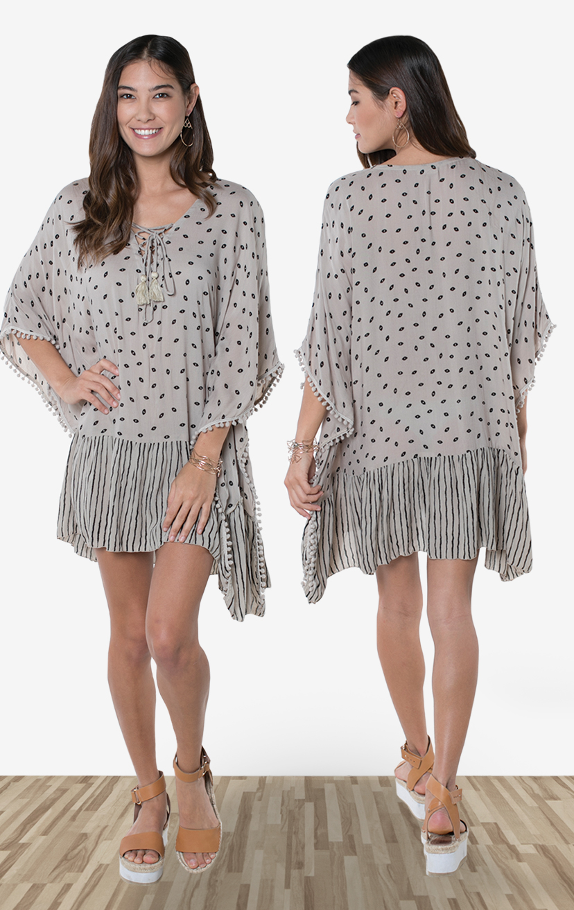 COVER-UP MARTINI     Lace-up neckline, wide kaftan sleeves, wide cut bodice cover-up, pom pom trim edges, ruffle hem  RAYON CRINKLE | XS-S-M-L