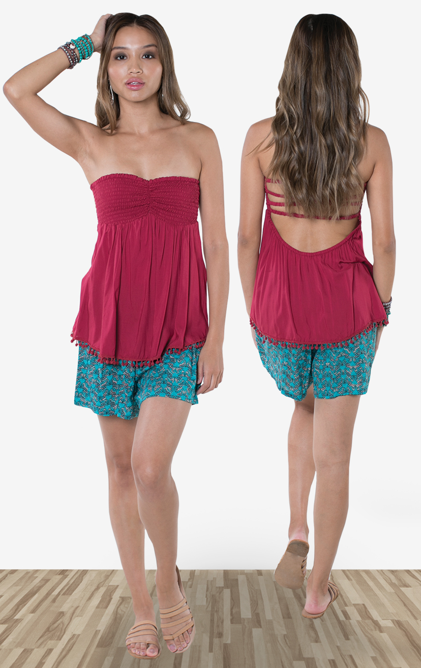 TOP ZANNA   Strapless, smocked-bodice x-back top, pom pom trim hem  100% RAYON | XS-S-M-L  –   SHORTS SKYLINE   Wide waistband shorts, back elastic, front button detail, side pockets  100% RAYON | XS-S-M-L