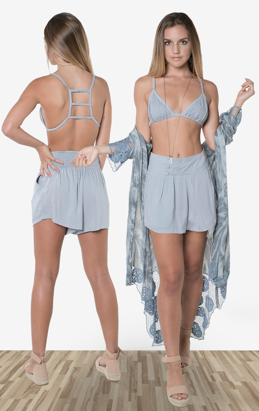 TOP AYU   Top smocked bikini front with three tiered back detail  100% RAYON | XS/S-M/L  –   SHORTS SKYLINE   Wide waistband shorts, back elastic, front button detail, side pockets  100% RAYON | XS-S-M-L