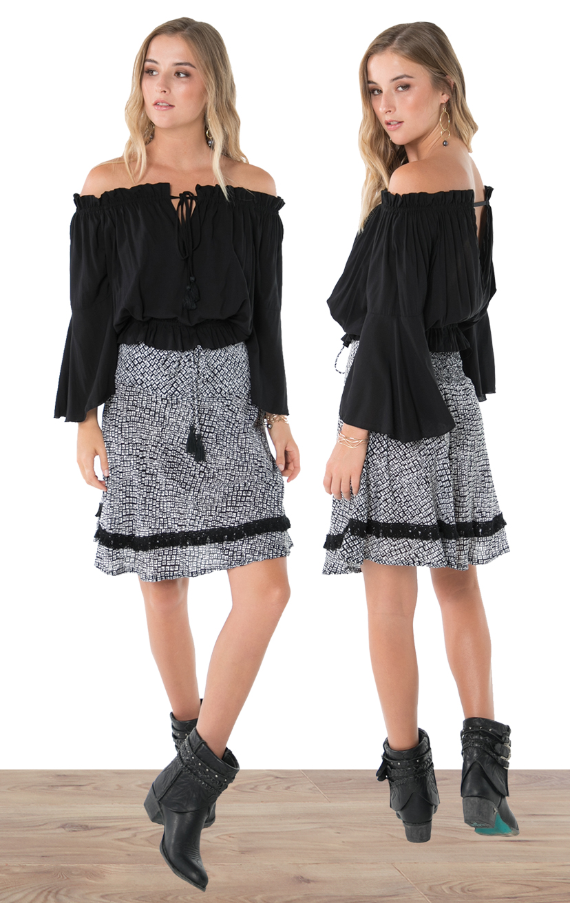 TOP DEVYN   L/s off shoulder tie front blousant top  100% RAYON | XS-S-M-L  –   SKIRT LOUIE   Above knee a-line skirt, back elastic, front drawstring w/ tassel, fringe detail lace  100% RAYON | XS-S-M-L