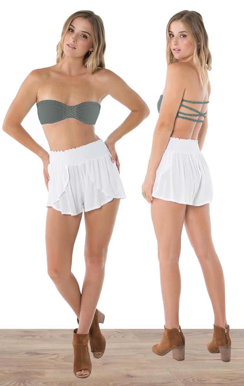 BANDEAU BLISS   Top smocked bikini front with three tiered back detail  100% RAYON | XS/S, M/L  –   SHORTS CHASER   Wrap style shorts, elastic waist  100% RAYON | XS-S-M-L