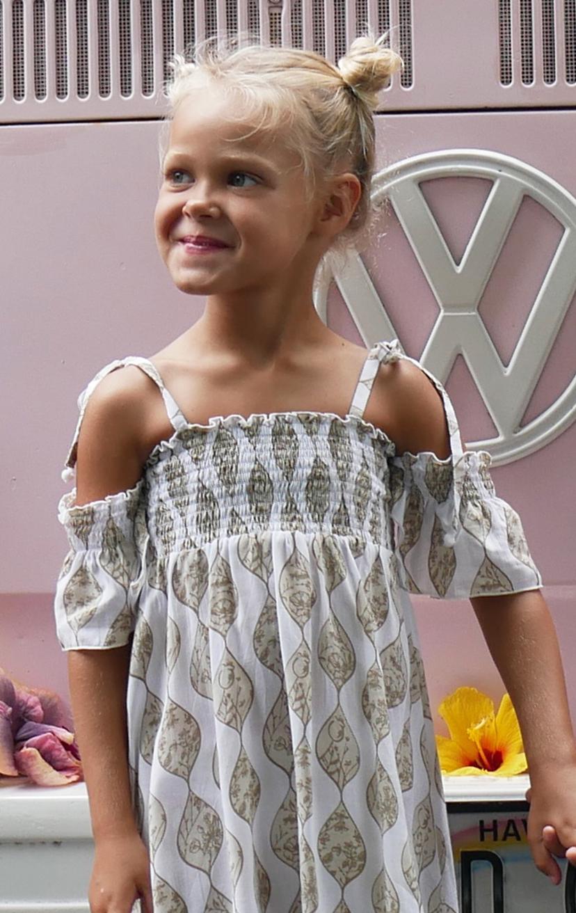 DRESS VANILLA   Cap slv smocked bodice, pom pom end spaghetti straps, pom pom bottom edge  100% RAYON | 2/3 | 4/5 | 6/7 | 8/10