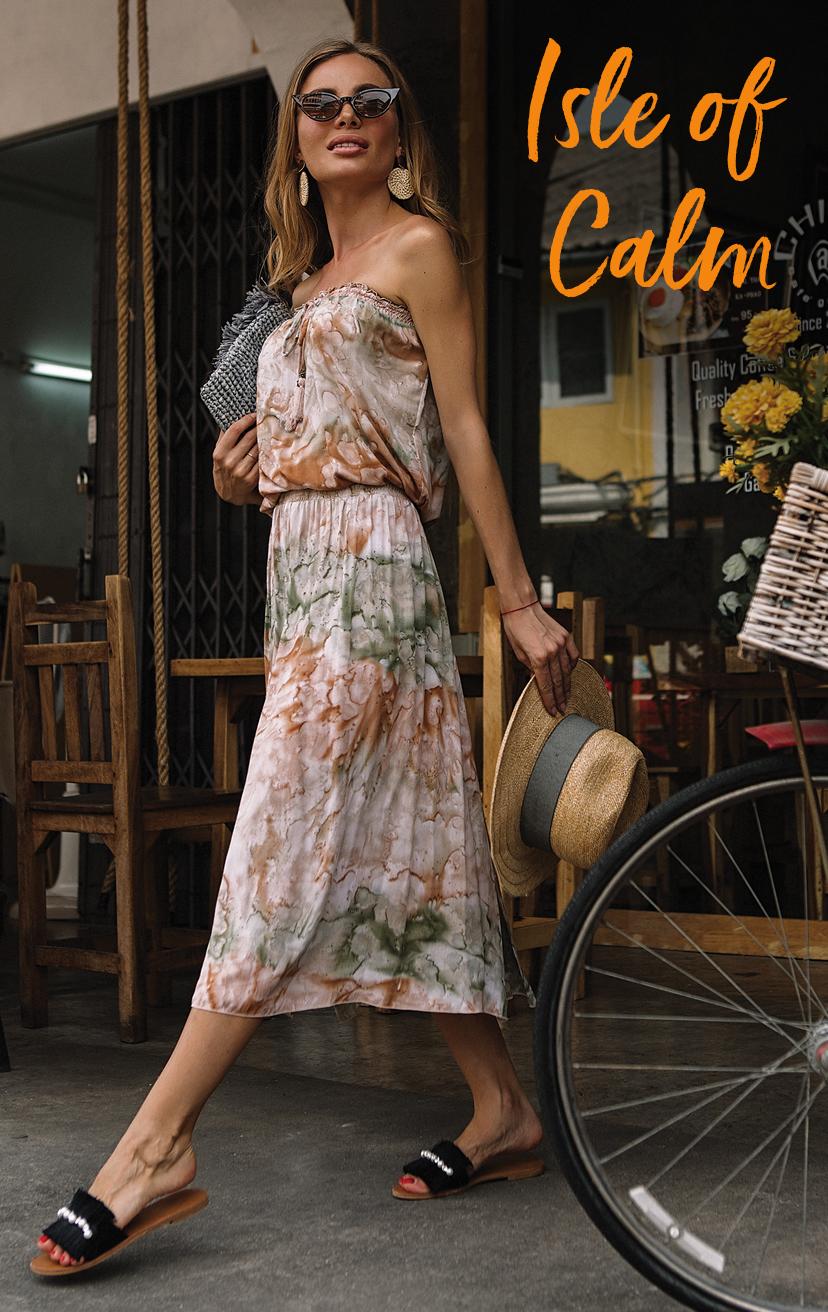 DRESS COSMO   Strapless midi dress, smocked waist, smocked top w/ pom pom end ties  100% RAYON | XS-S-M-L