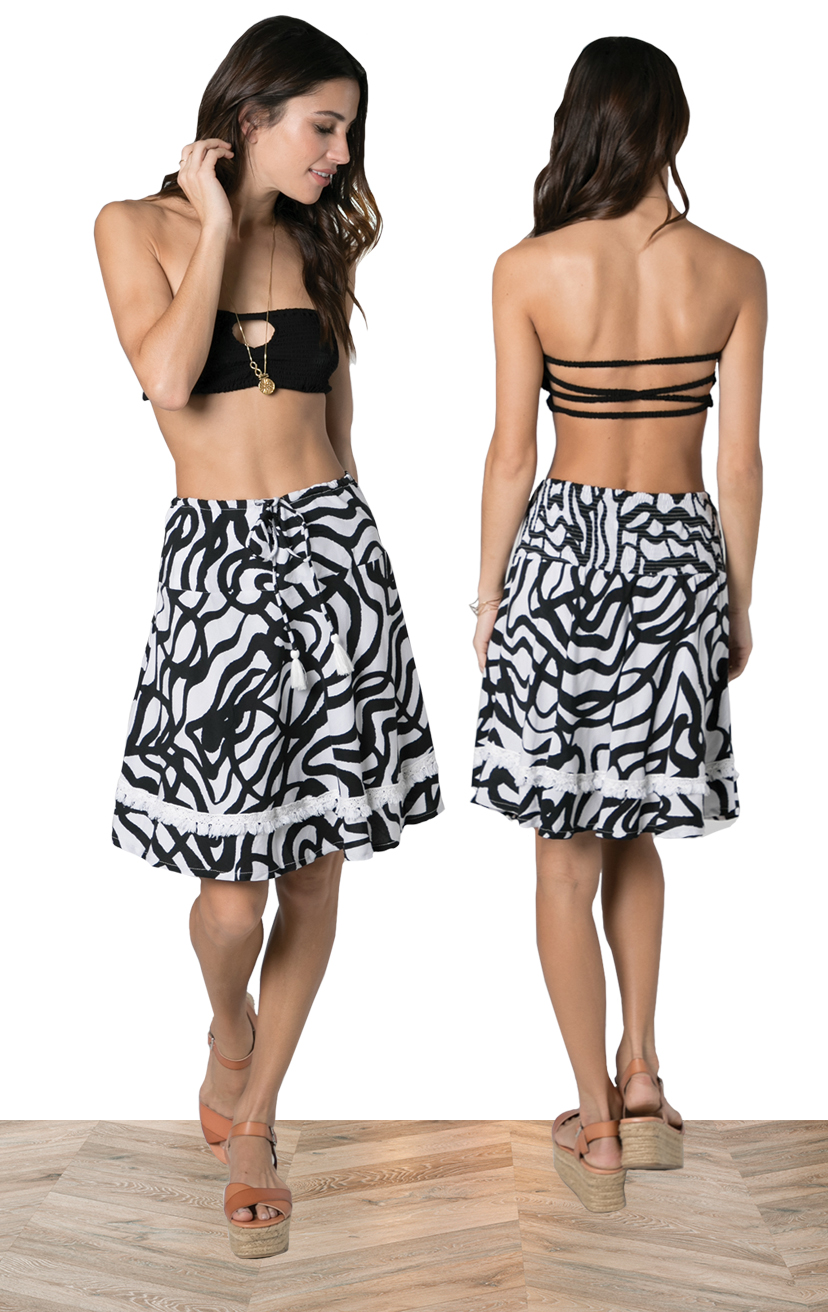 BANDEAU EDEN   Keyhole smocked bandeau, x back elasticized straps  100% RAYON | XS/S, M/L  –   SKIRT LOUIE   Above knee a line skirt, back elastic, front drawstring w/ tassel, fringe detail lace  100% RAYON | XS-S-M-L