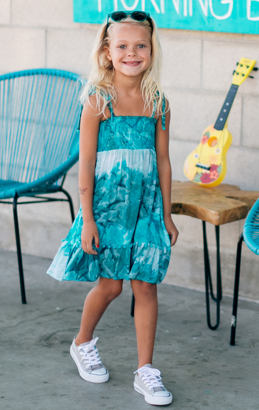 DRESS OLIVIA   Spaghetti straps top smocked dress, w/ pom pom detail  100% RAYON | 2/3 | 4/5 | 6/7 | 8/10