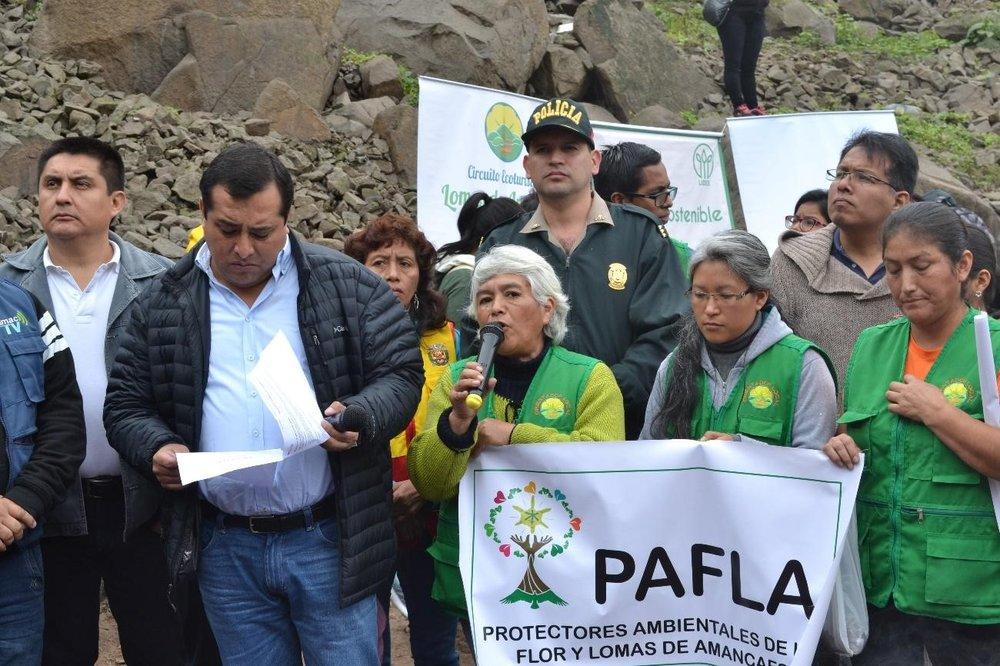 El alcalde del Rímac, Enrique Peramás, y Haydée Cerrón de PAFLA brindando palabras de bienvenida