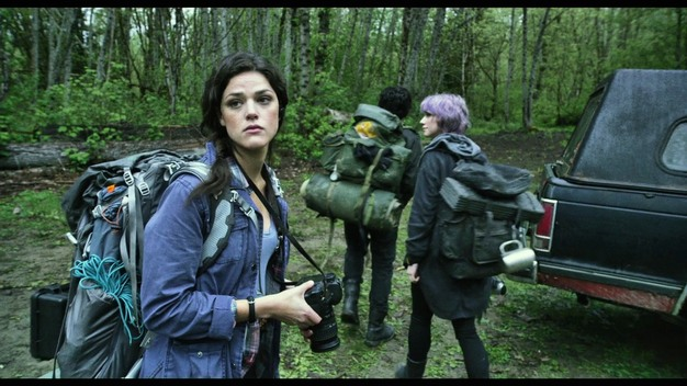 Callie Hernandez prepares to venture into the woods.