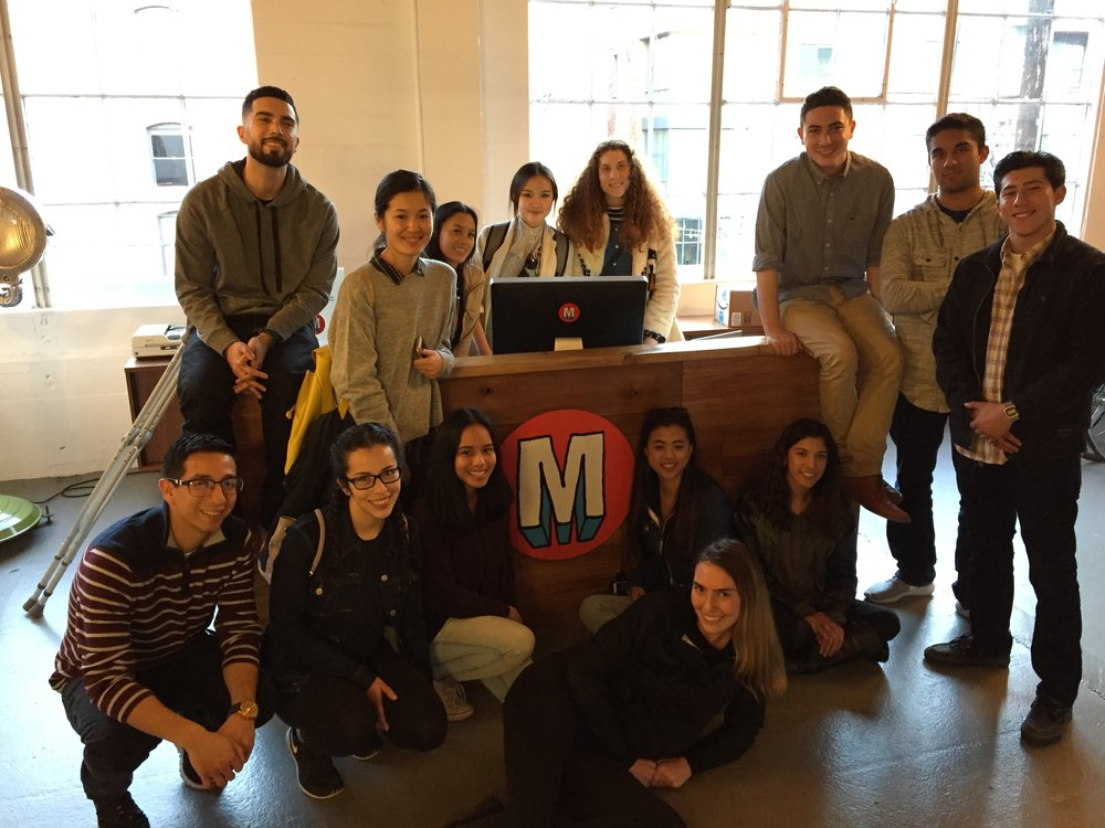 MA members surrounding the front desk of Mekanism's San Francisco Office.
