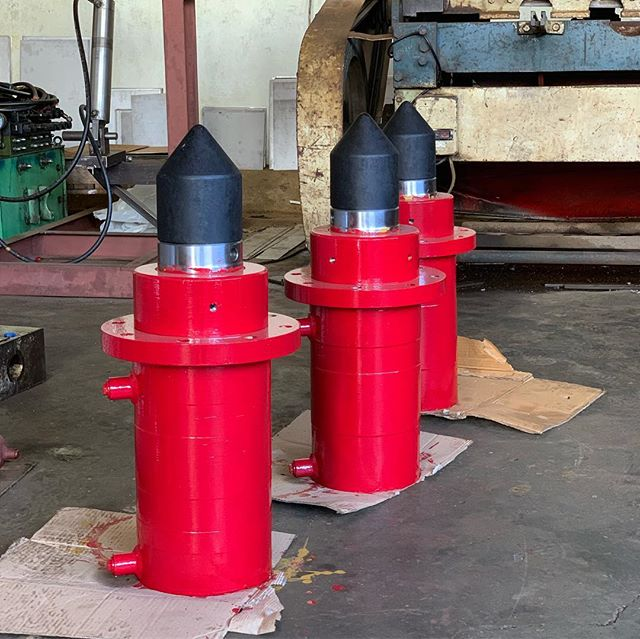 Hydraulic solution to crush piles.  We got this welcoming opportunity to help make easy demolition of strong old pile foundation and columns.  These missile looking Christmas red crusher can make 68 tons each. They have to be cradled in to their links, swipe left to see it in one. These links are then joined to each other to form a circular circumambient ring. A ring of ten links can make 680 tons stone crumbling force to bring down about meter wide pile. If you wanna visualise it, YouTube 'Pile crusher'. #hydraulics #makeinindia #madeinindia