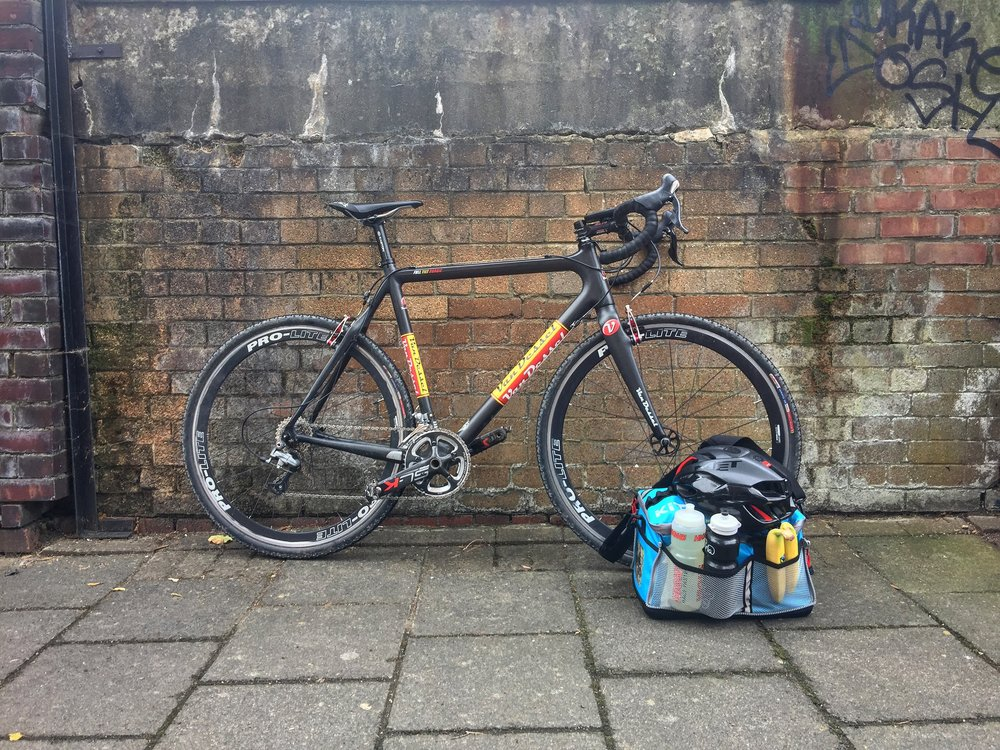 The Van Dessel Full Tilt Boogie is equipped with Shimano Ultegra, FSA SLK Crankset and a Fizik Antares saddle, TRP Mini V brakes and Pro Lite aluminium rims with Challenge Grifo Pro 32 tyres. Kit bag supplied by KitBrix. Helmet is the MET Rivale. Bananas from the corner shop.