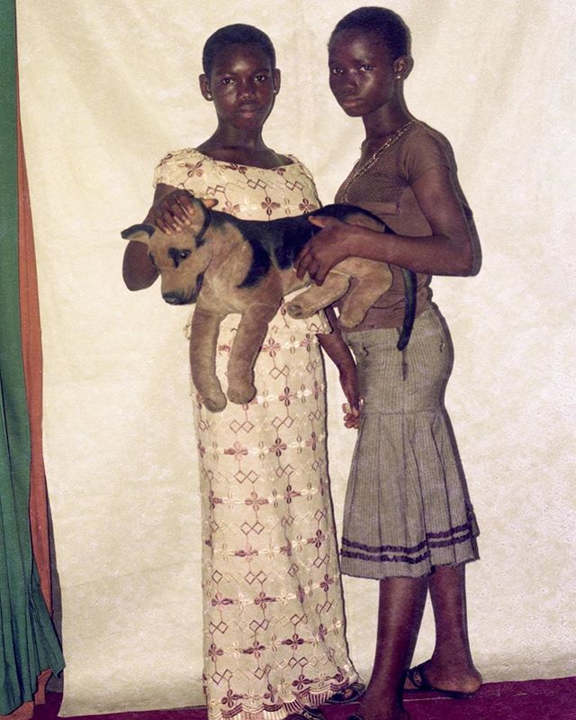 """Two girls with toy dog""(date unknown) from ""Lagos Studio Archives"" an ongoing project by Karl Ohiri."