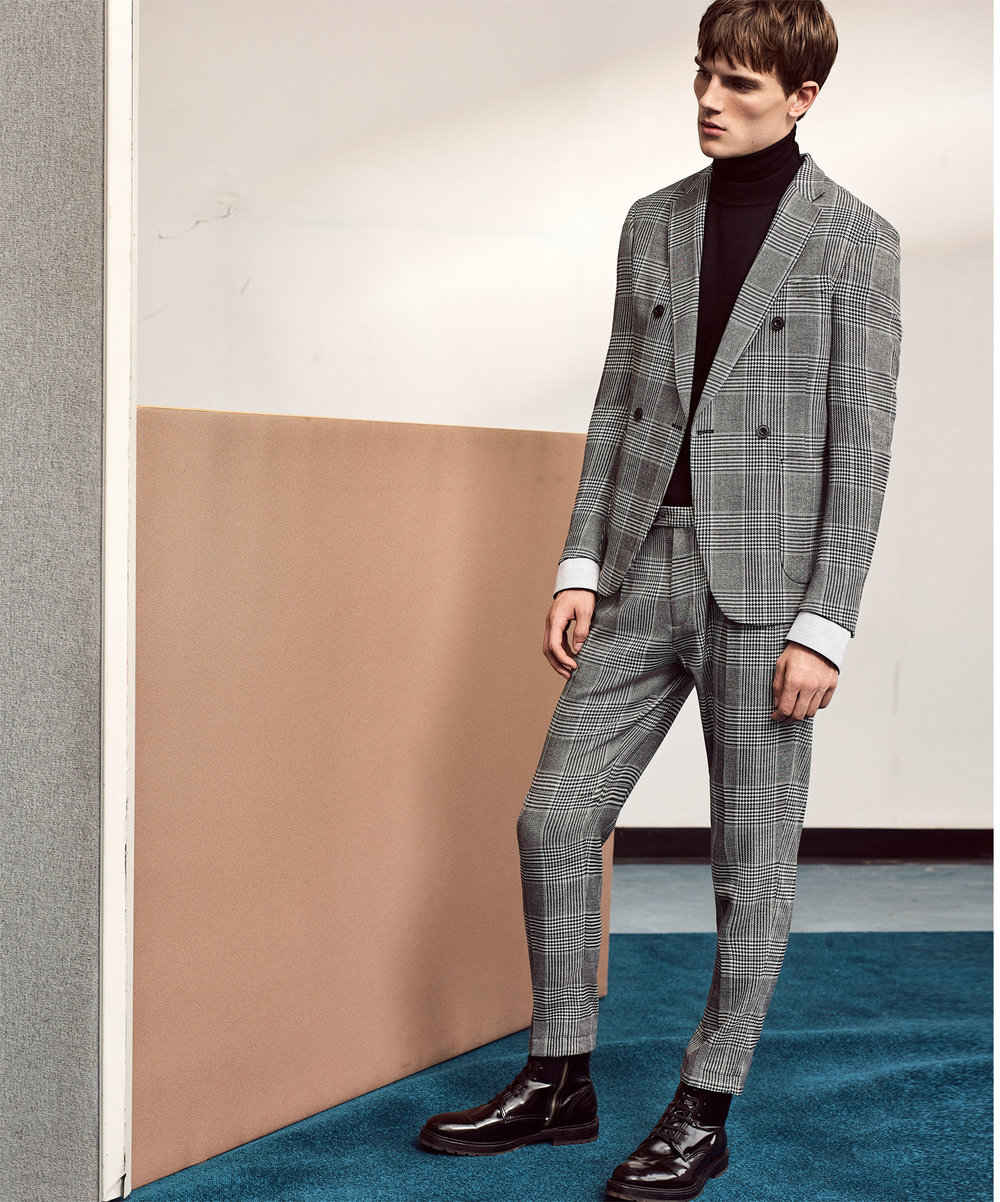 Check double-breasted suit blazer,  £69.99  Check trousers , £29.99  Turtleneck sweater , £25.99  Striped shirt , £25.99