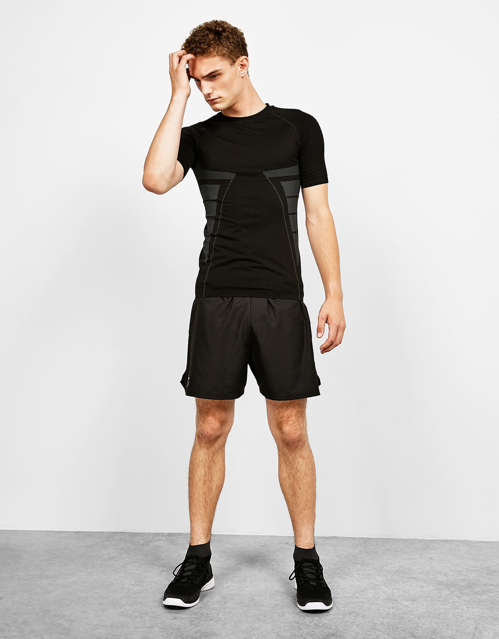 Seamless technical sport T-shirt, £12.99 Sports Bermuda shorts with reflective detail, £15.99 Men's faux sock ankle boots, £39.99