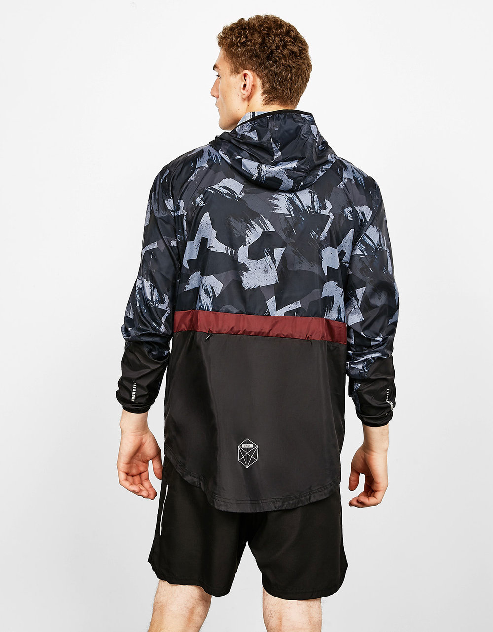 Technical sport jacket with full print, £45.99 Sports Bermuda shorts with reflective detail, £15.99