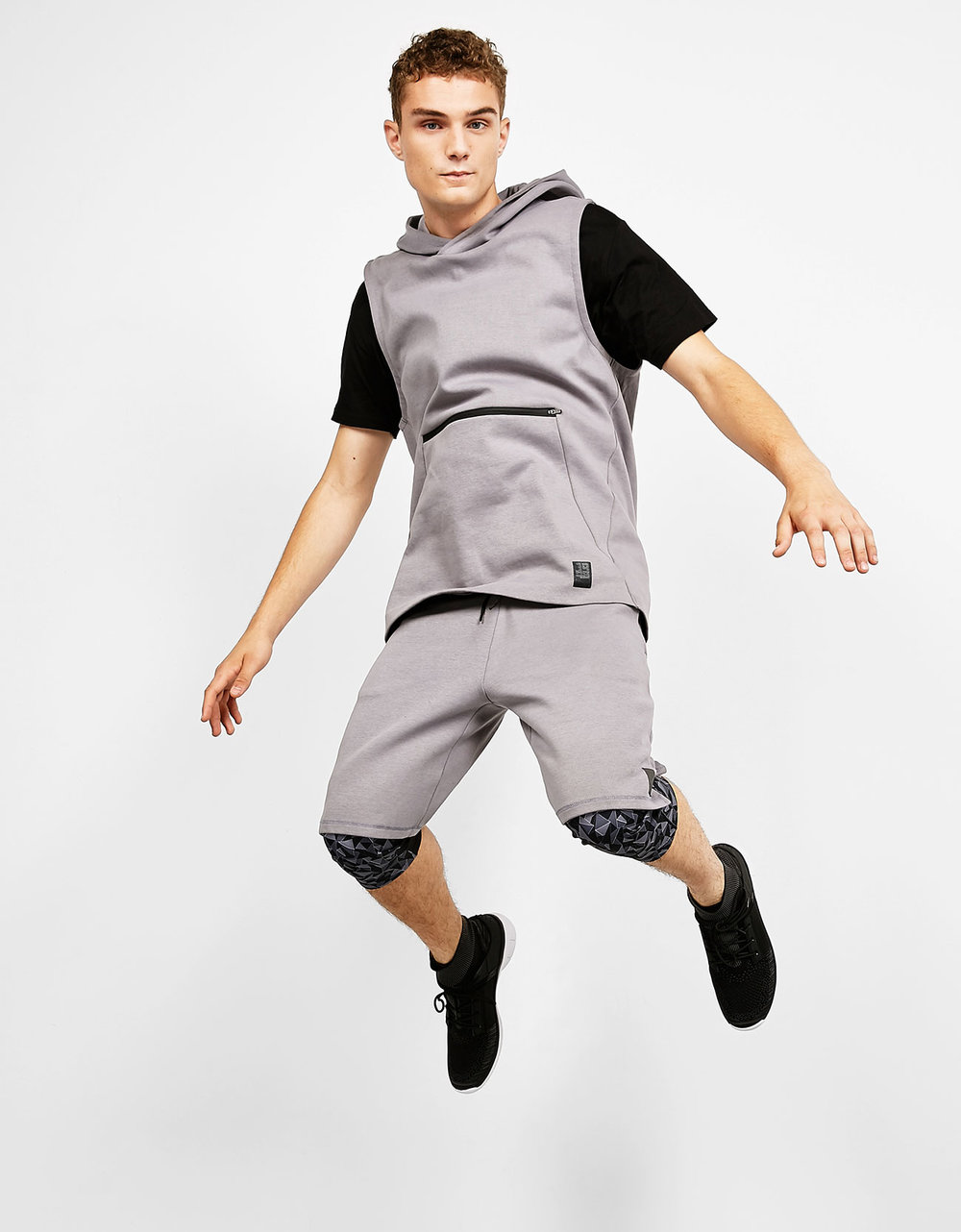 Hooded plush sport waistcoat, £22.99 Sports Bermuda shorts with zip detail, £19.99 All over print sport trousers, £19.99 Men's faux sock ankle boots, £39.99
